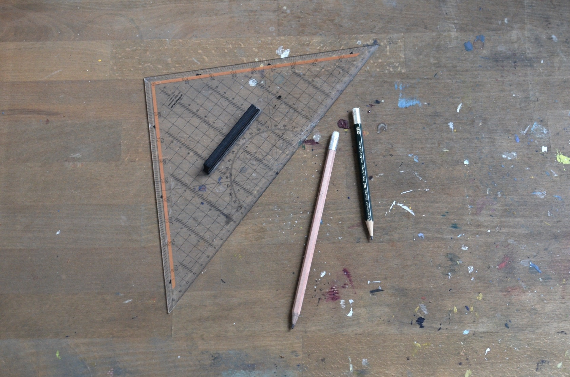Geometry tools on a table including pencils, charcoal and a ruler.