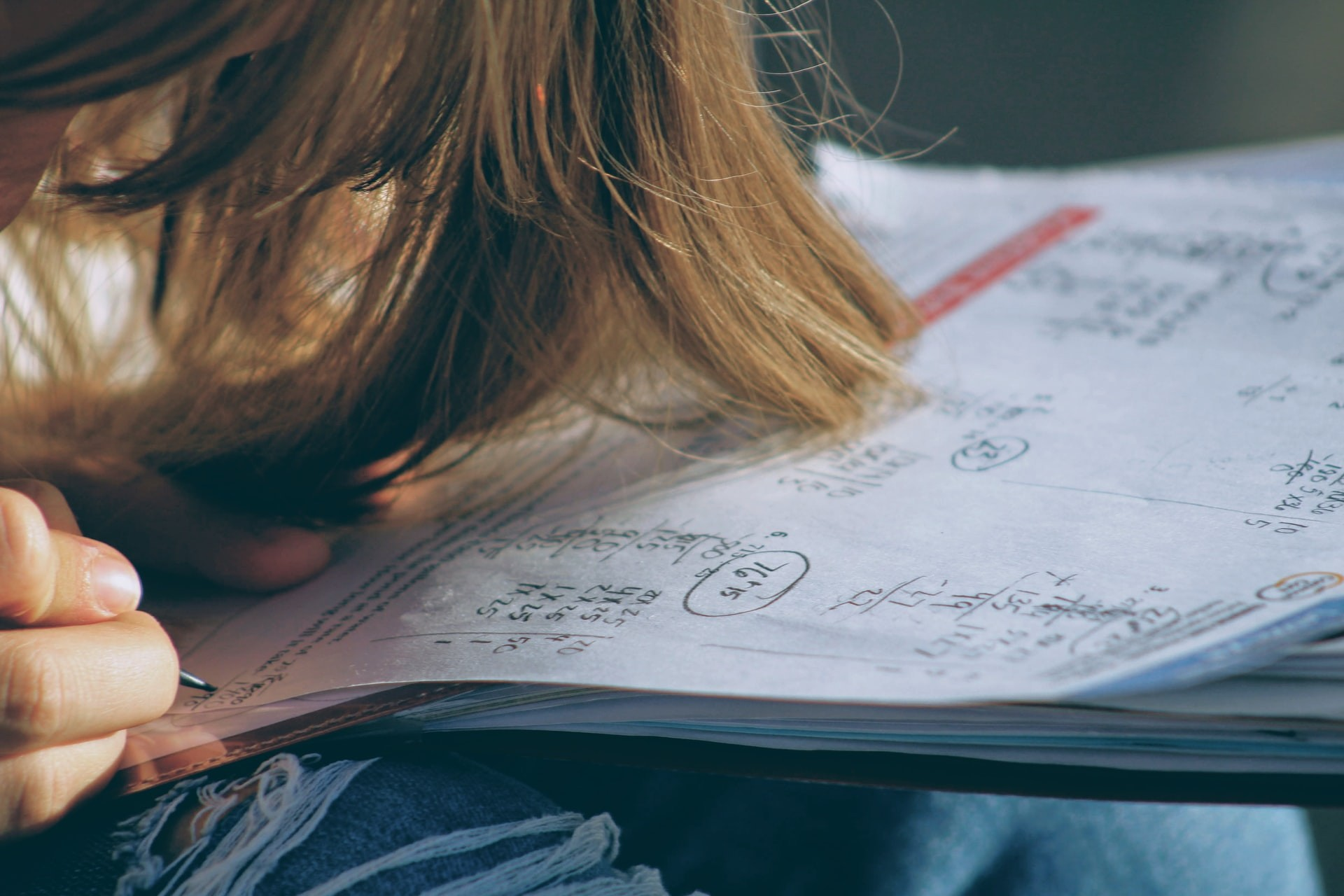 Close-up of student completing a math worksheet.