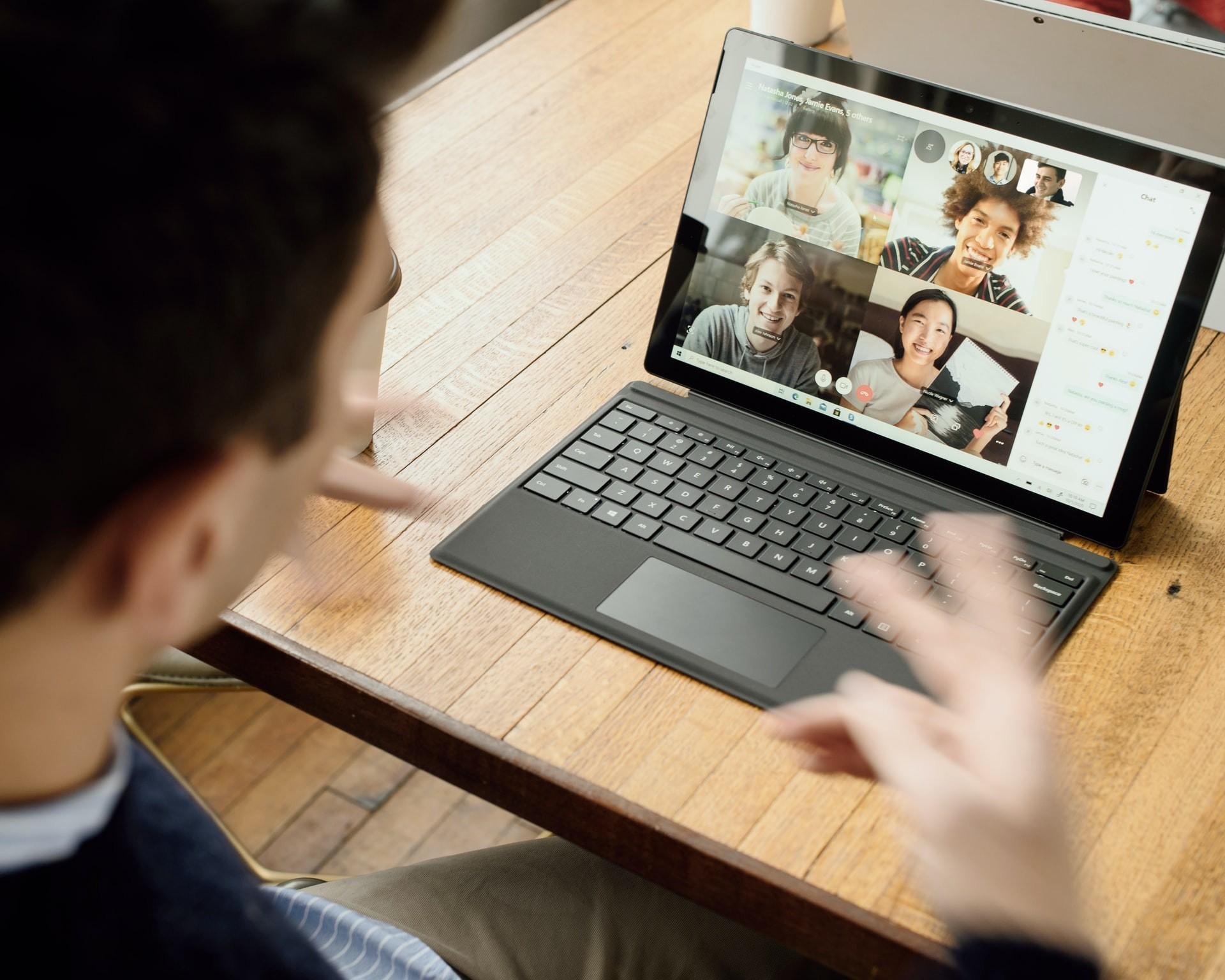 Teacher talks to students through an online learning platform video call.