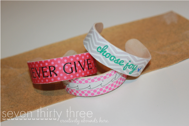 "Kids' bracelets made from popsicle sticks and decorated with patterns and phrases ex. ""choose joy."""