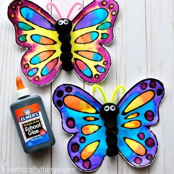Colorful butterflies painted in watercolors.