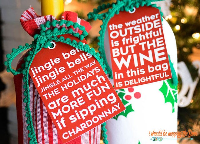 Wine bottles with holiday wrapping and gift tags.