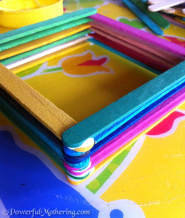 Small treasure box made from layers of colorful popsicle sticks.