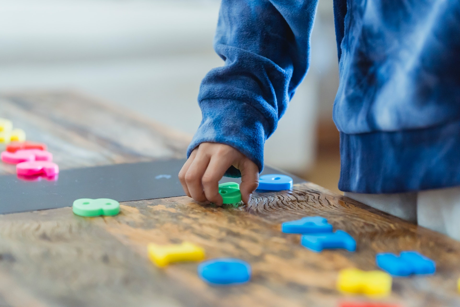 Student uses number blocks to play classroom math games