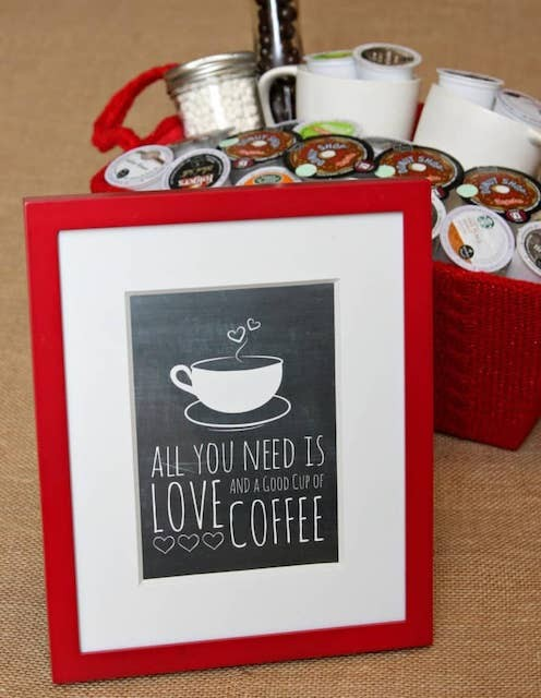 """Picture of a coffee cup with writing underneath that reads """"all you need is love and a good cup of coffee."""""""