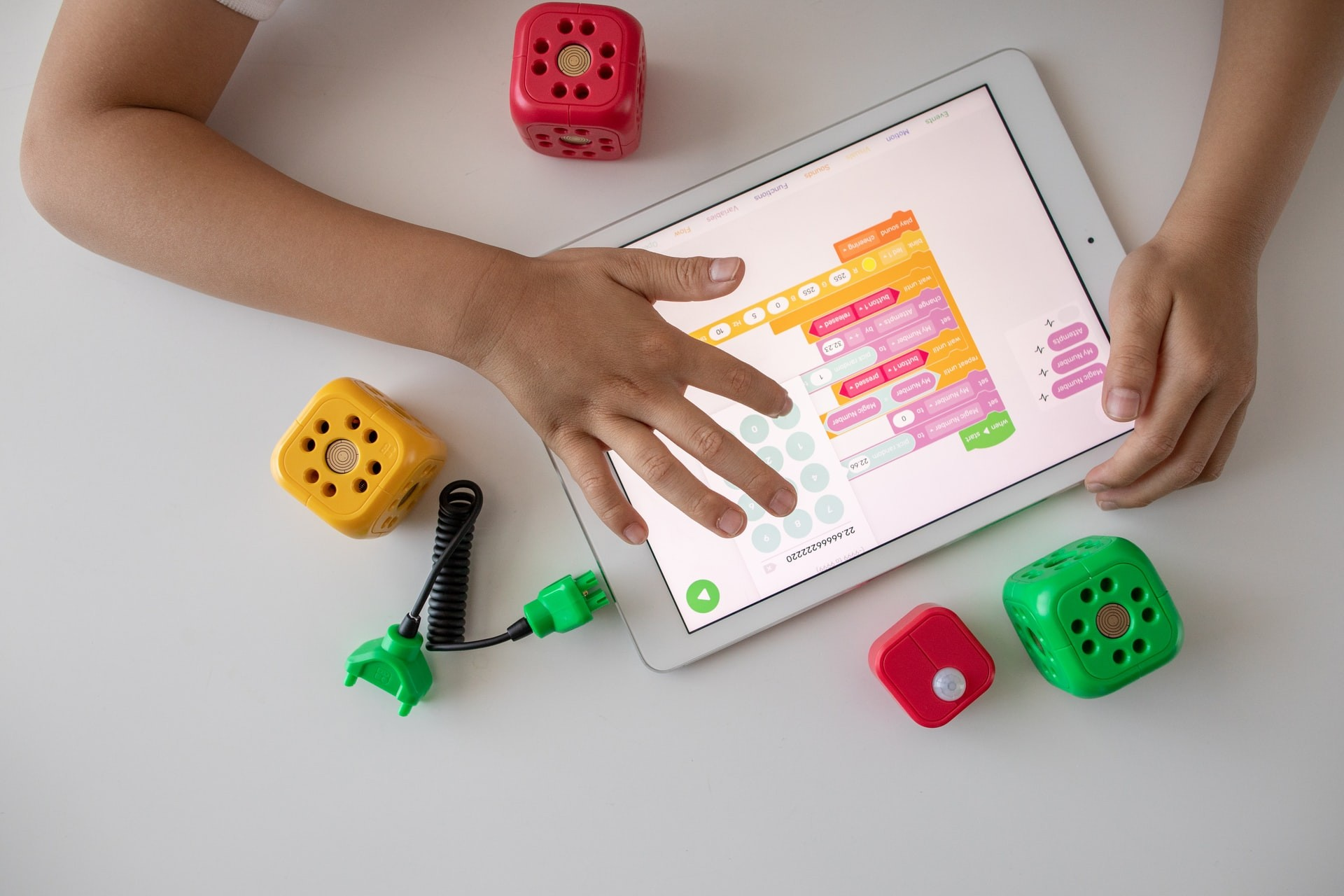 A student uses a tablet for game-based learning.