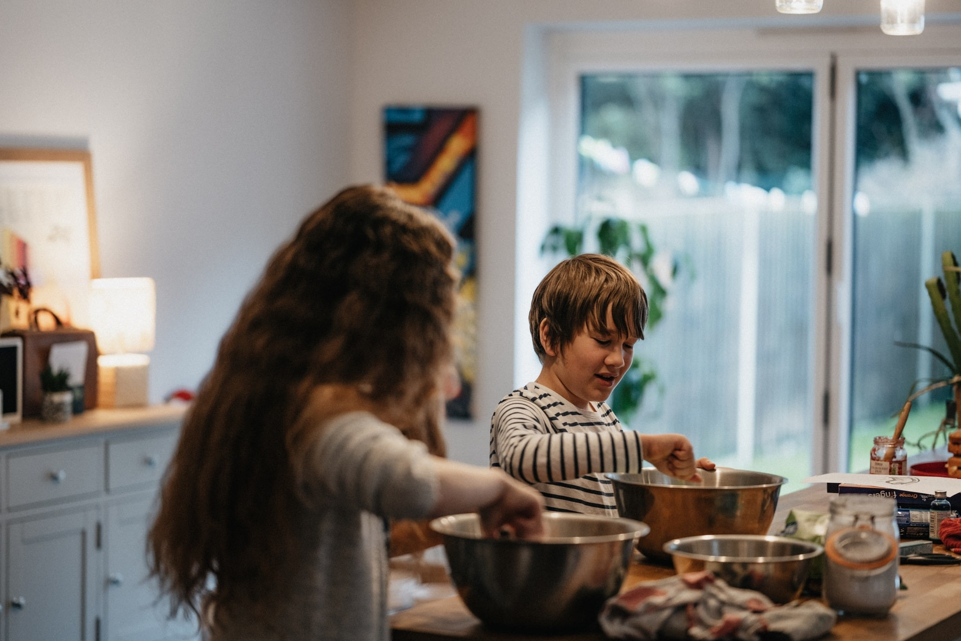 Two children bake in a kitchen and make dirt cup treats in honor of Earth Day