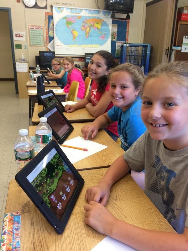 Students playing Prodigy on tablets