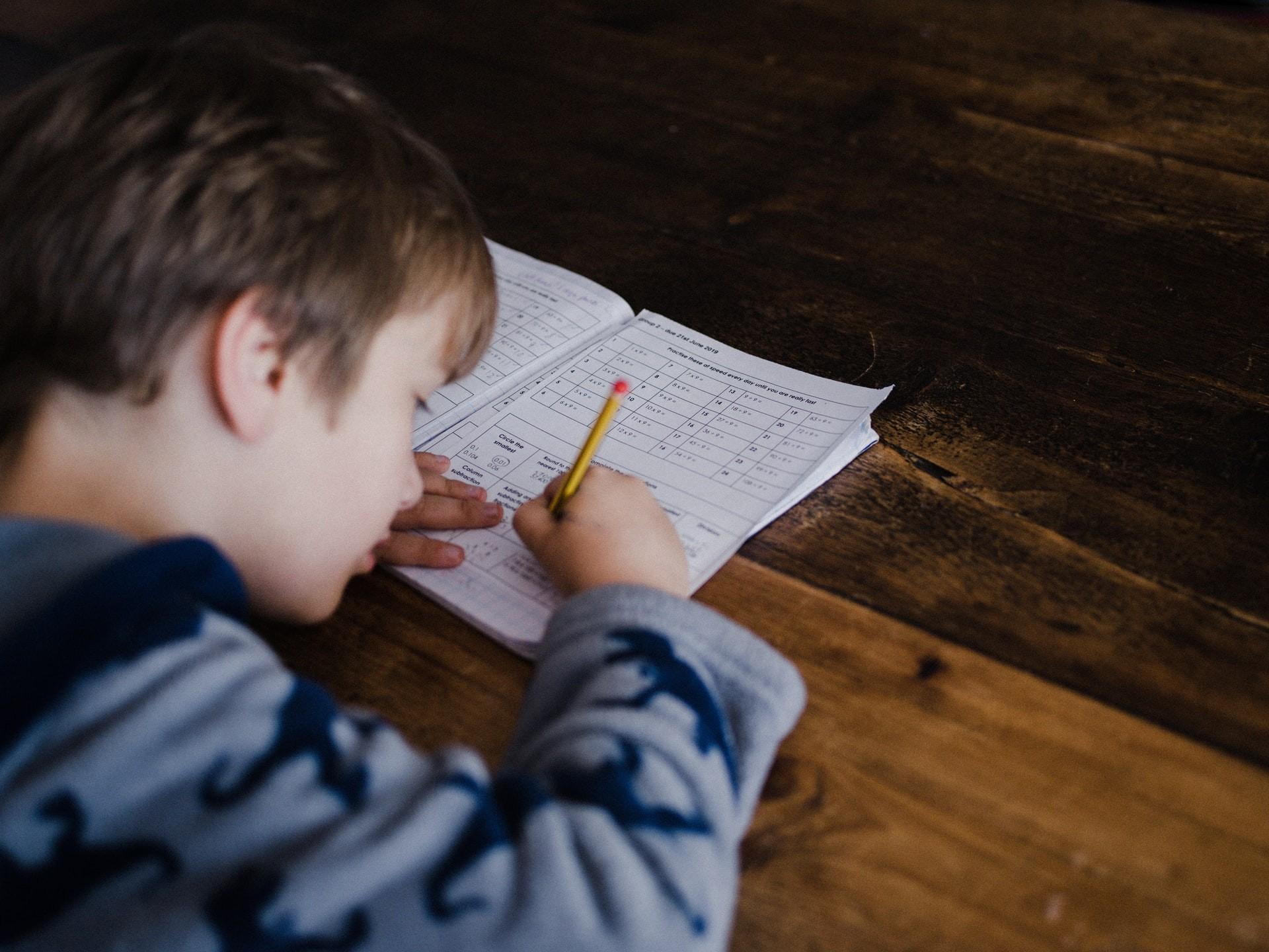 child doing math work
