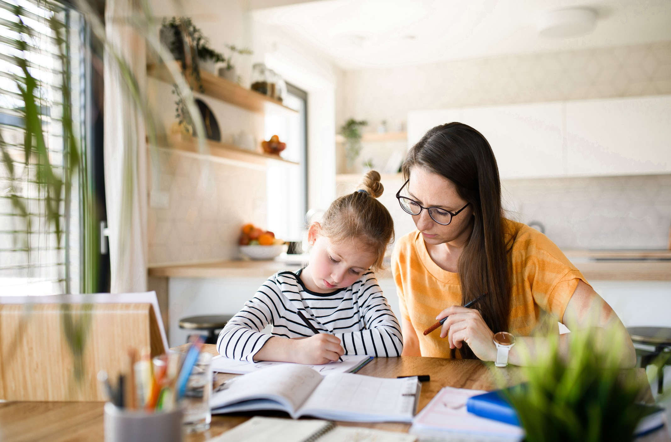 parent helping her child with homework