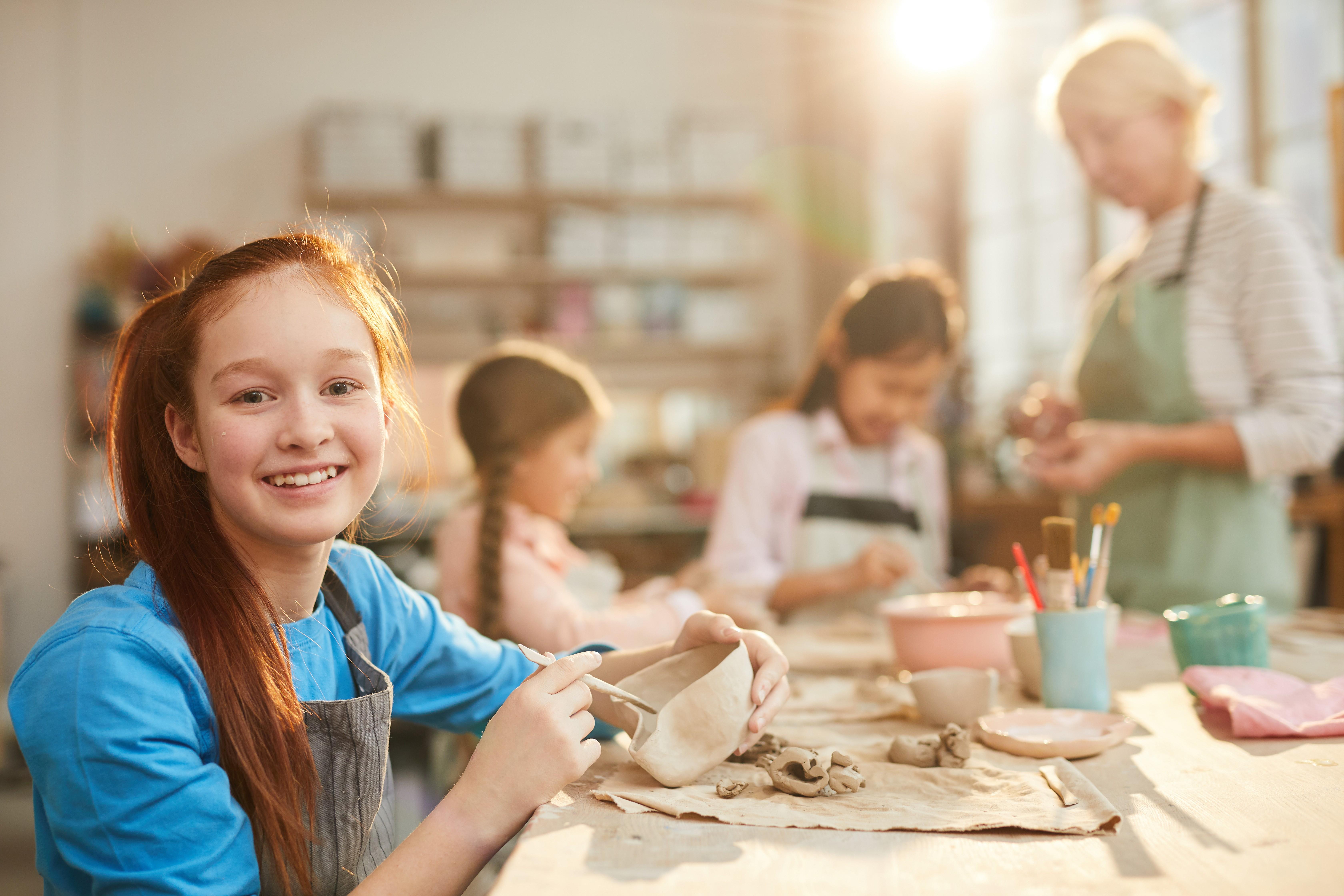 girl enjoying a pottery class