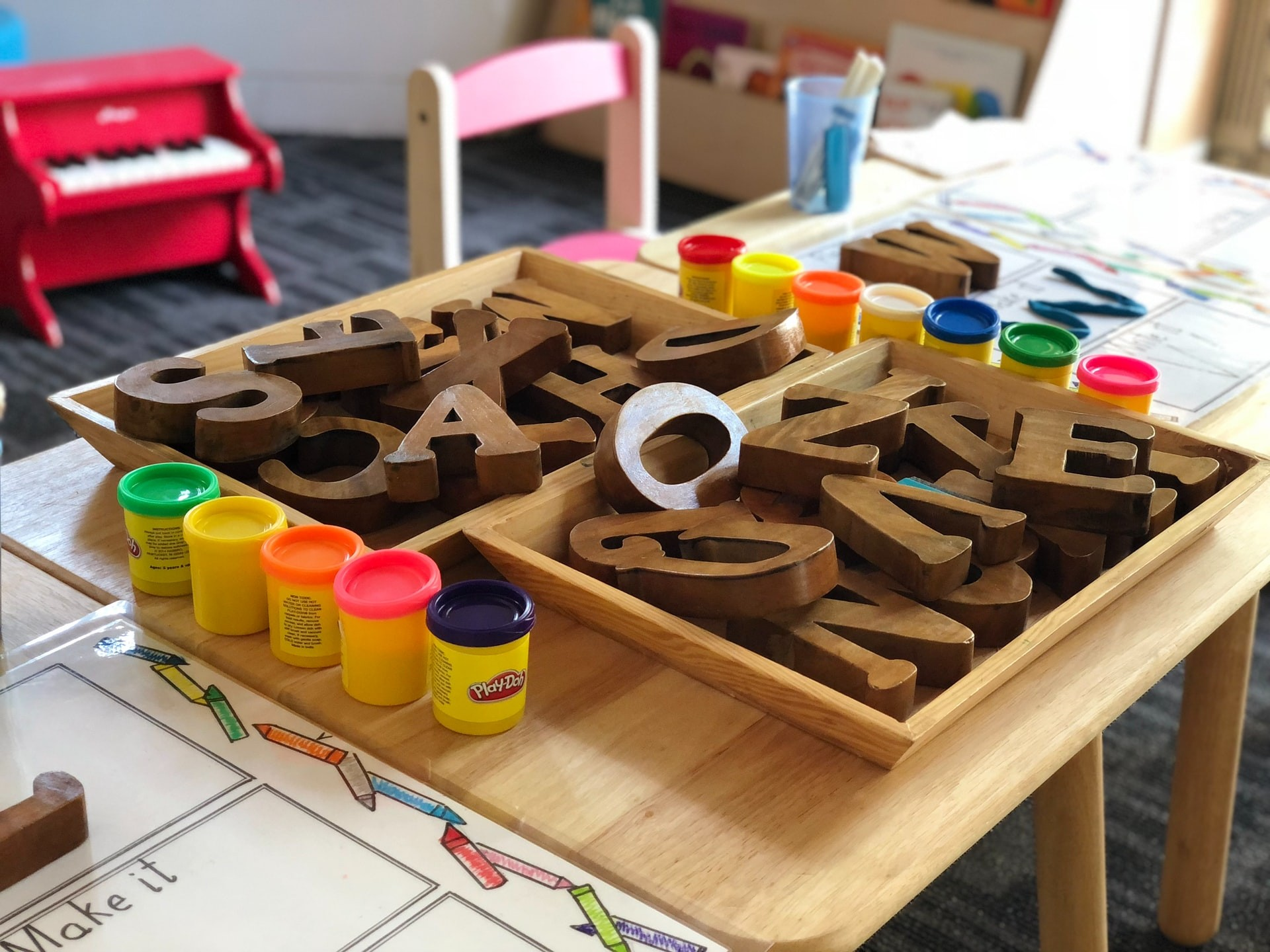 Wooden blocks and play-dough set out as part of a preschool lesson plan