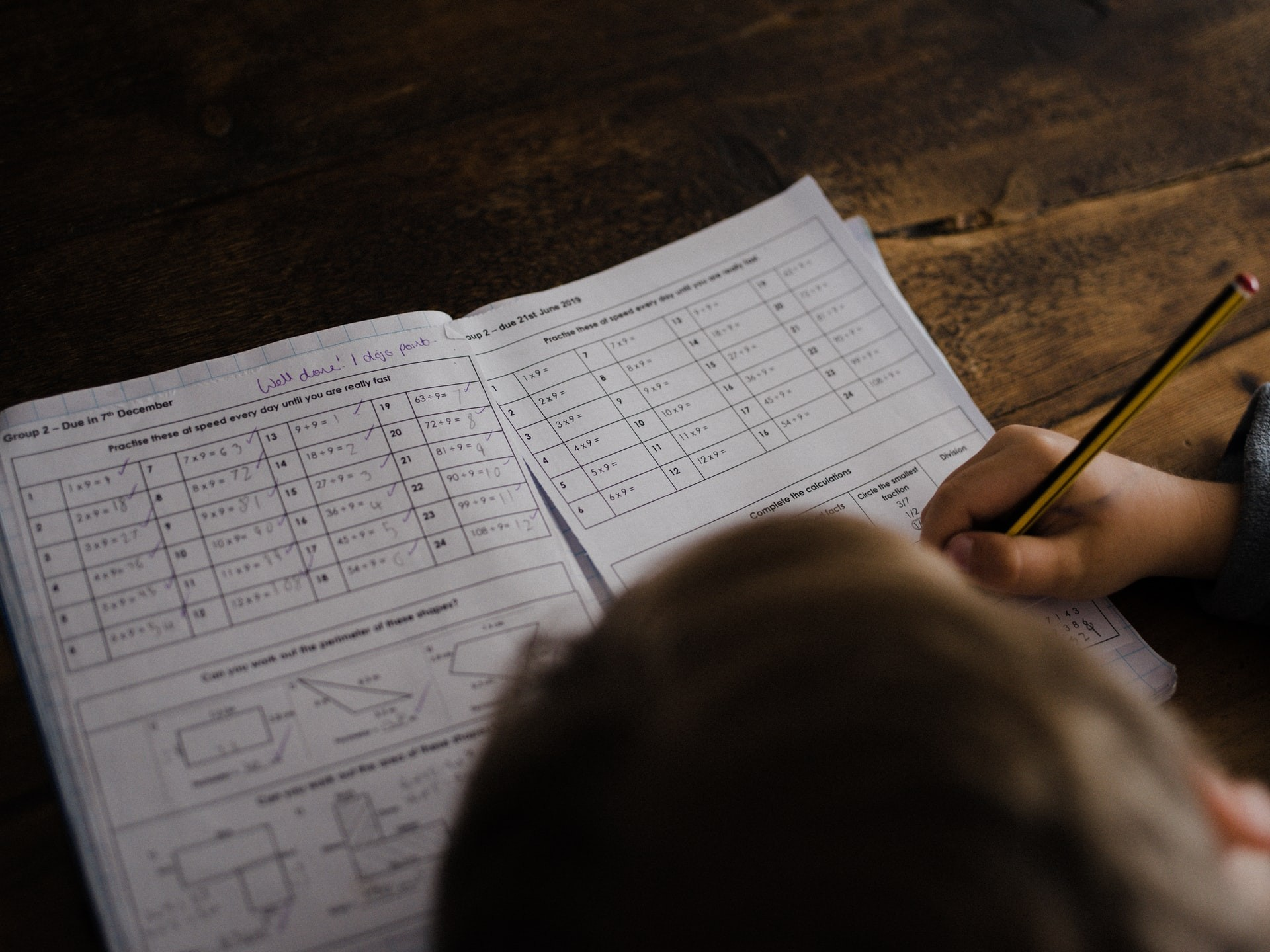 Student completes a math worksheet.