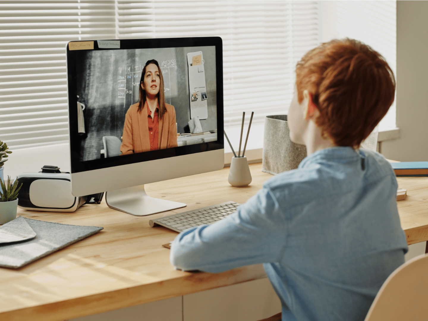 child learning with a remote online tutor
