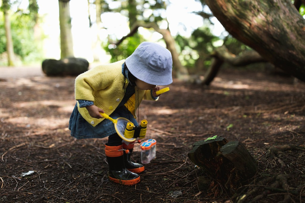 Unschooled child learning and exploring outside