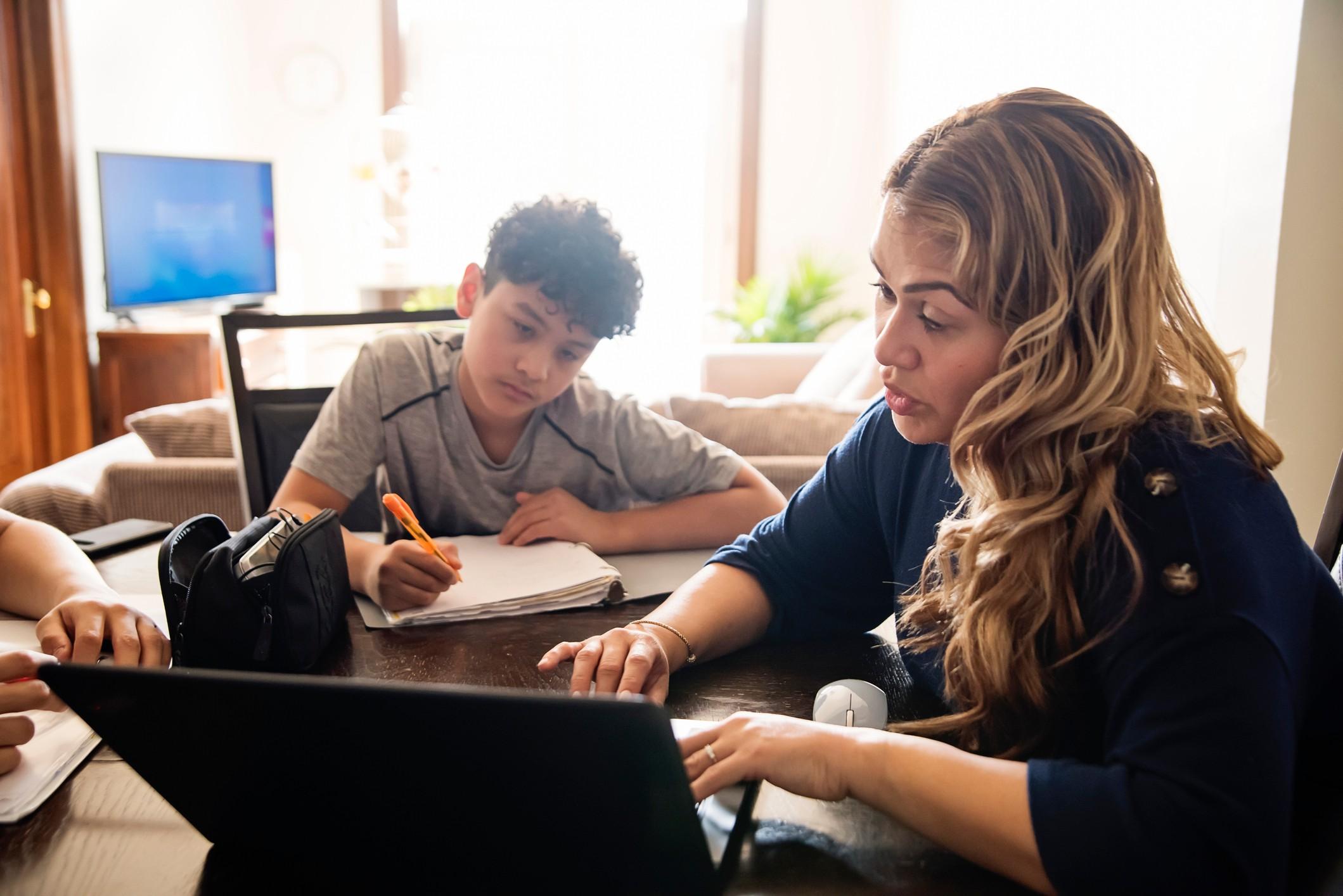 Mother homeschooling her son