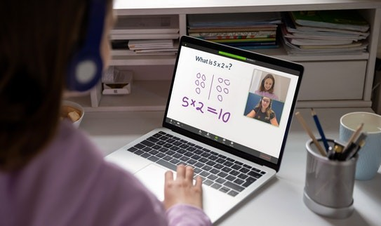 A child interacts with their Prodigy online math tutor through their laptop