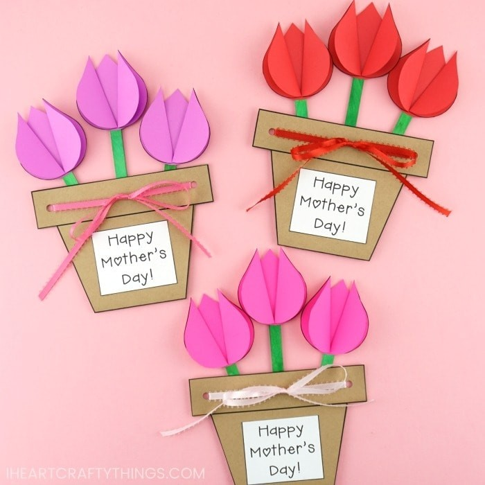 """Flower pot cards that read """"Happy Mother's Day"""" with pink, purple and red paper tulips."""