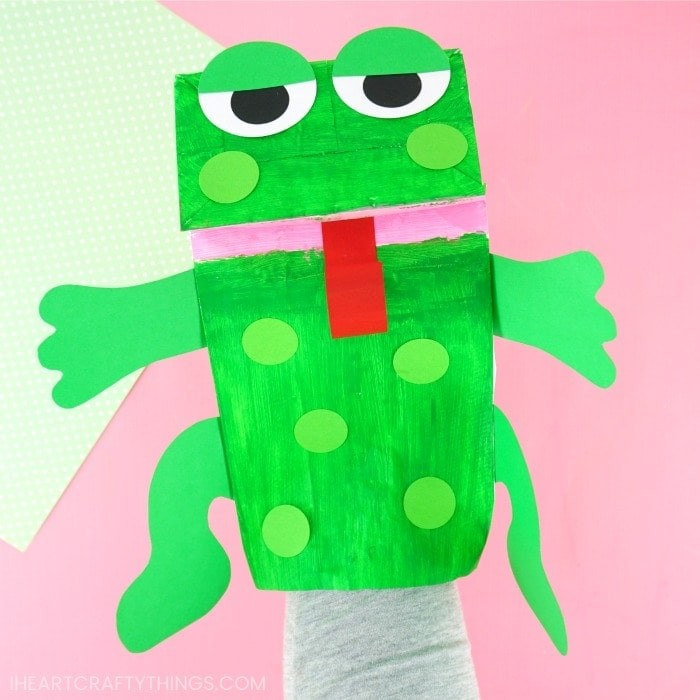 Cute green frog puppet made from a paper lunch bag.