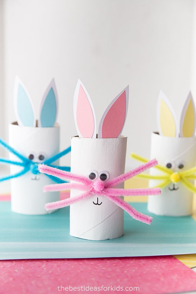 White toilet paper rolls decorated to look like bunnies.