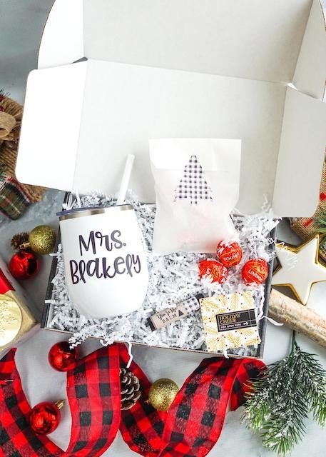 Gift box including personalized mug with teacher's name written on it.