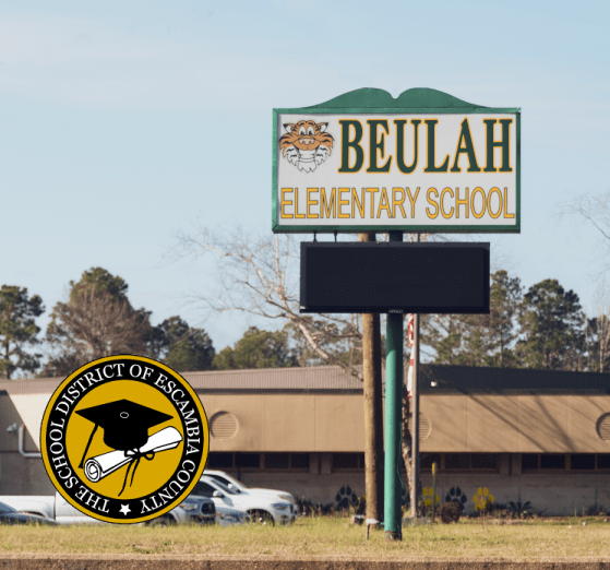 A picture of the outside of Beulah Elementary School in Escambia County, Florida with the school district logo.