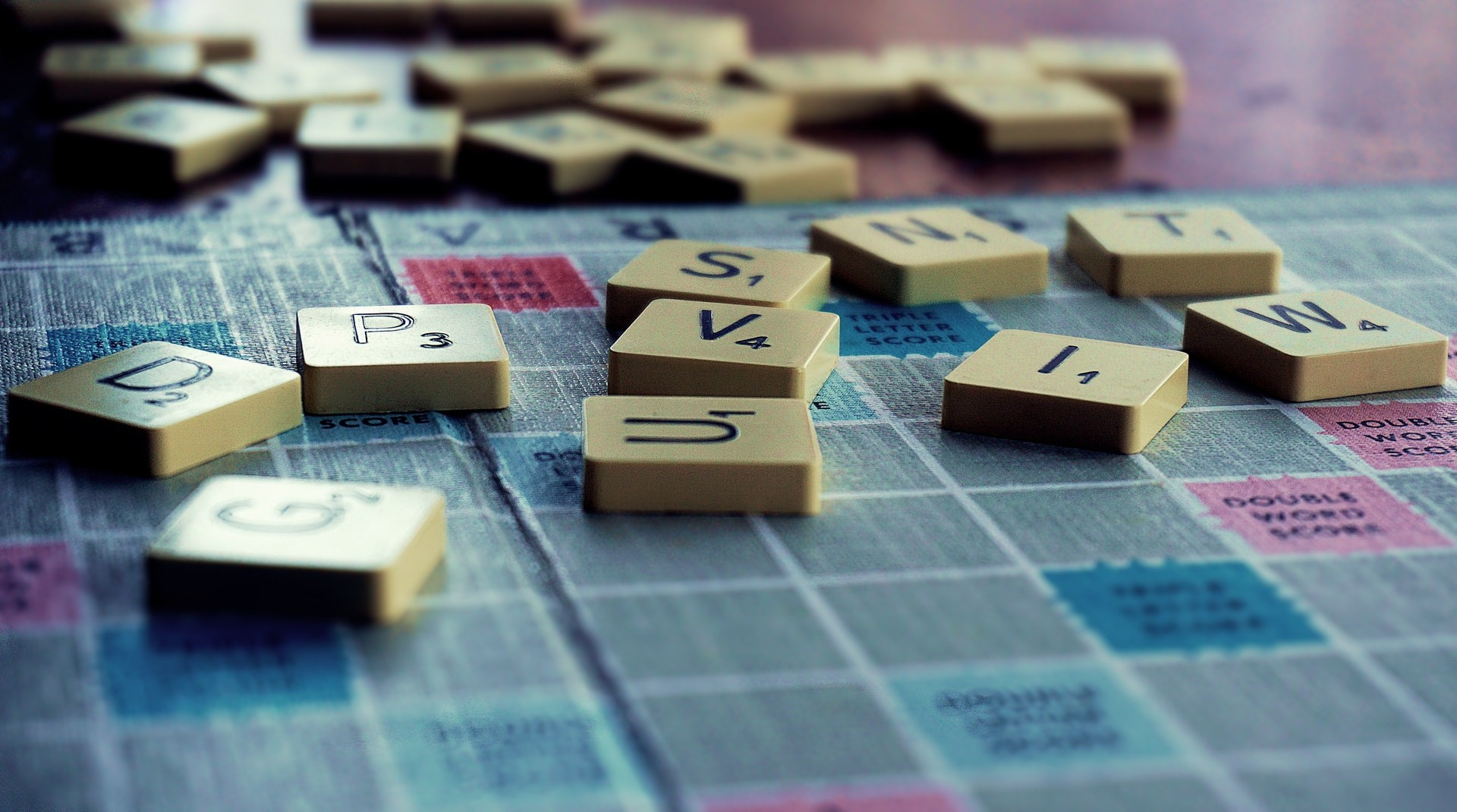 Picture of scrabble board with tiles on it.