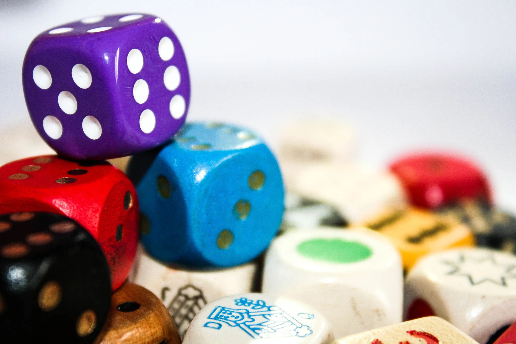 Pile of colorful dice for classroom math games.