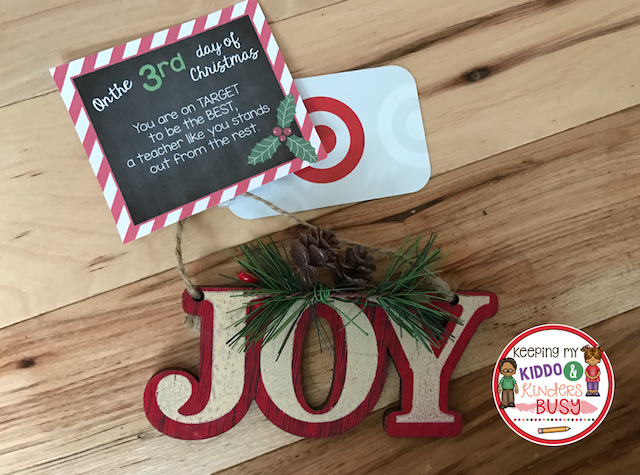 """""""Joy"""" ornament with gift tag and Target gift card attached."""