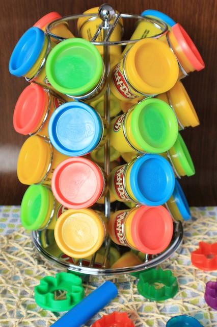 Coffee pod carousel holding tubs of play dough