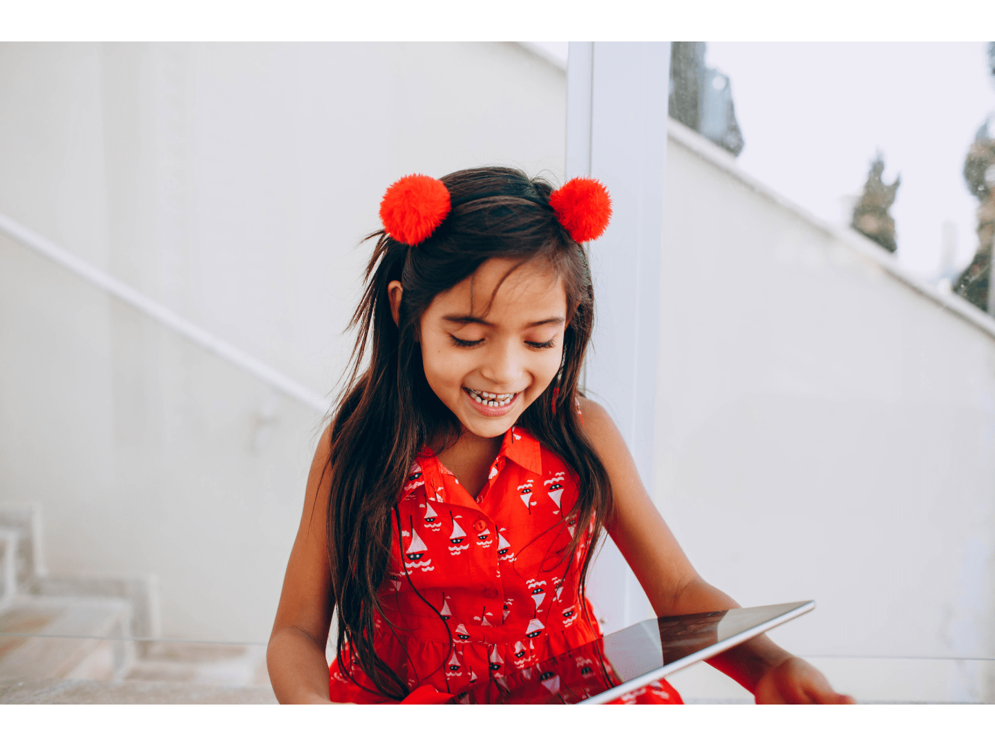Cheerful child looking at a tablet device