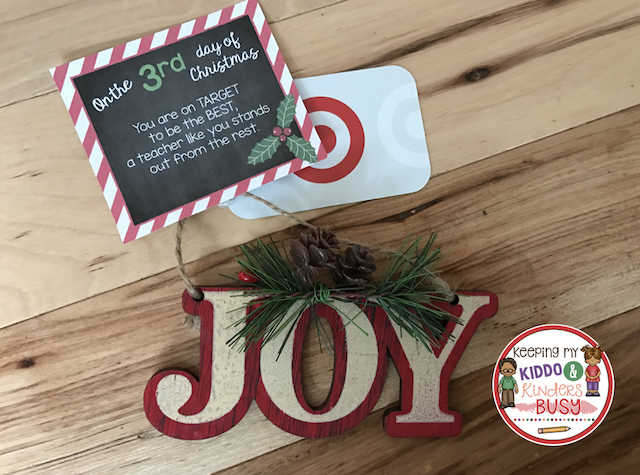 """Joy"" ornament with gift tag and Target gift card attached."